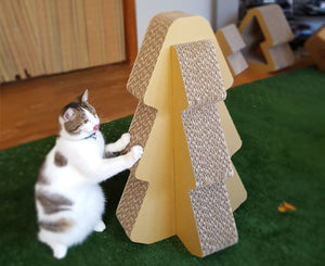 Cat and the standing scratcher tree