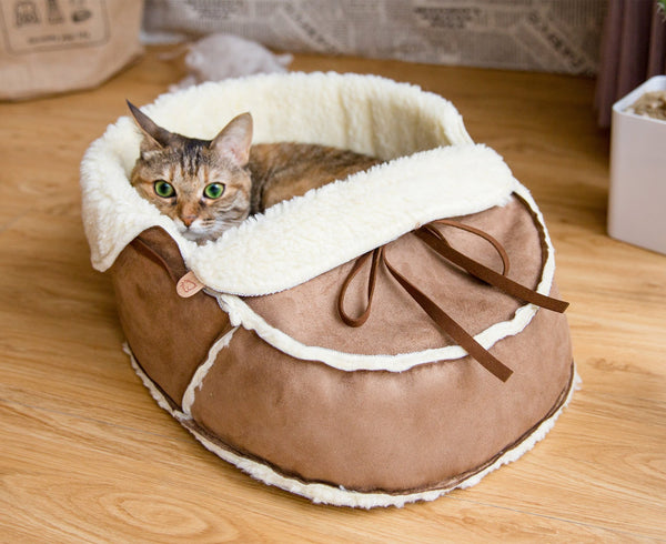 Moccasin Bed in Mocha with a cat in it