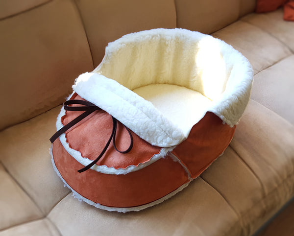 orange moccasin pet bed in perspective view