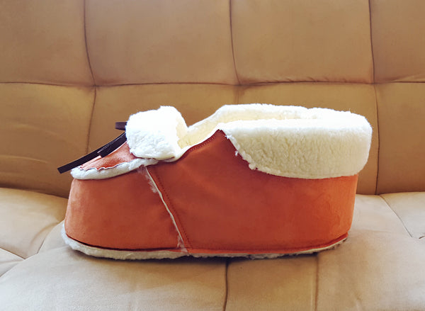 orange moccasin shoe cat bed side view