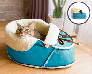 blue moccasin bed with a matching cat toy gift set