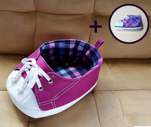 purple sneaker cat bed with a matching shoe toy