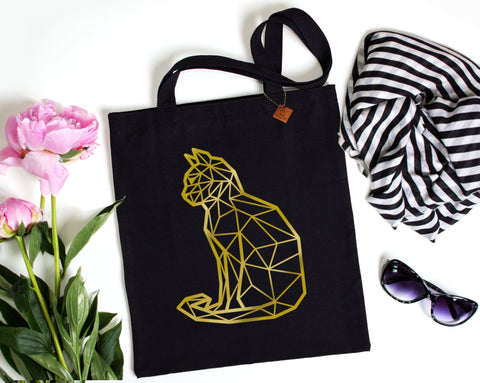 gold foil cat print on a black tote bag
