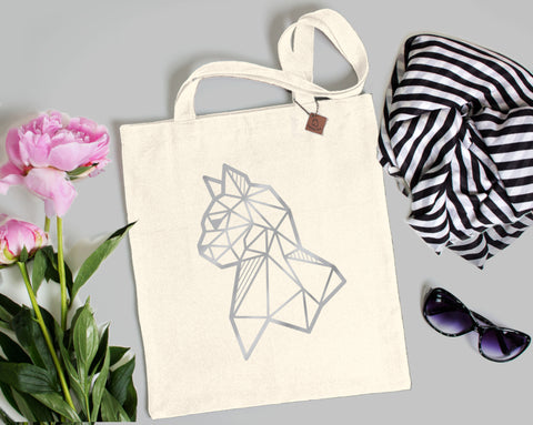 silver cat print on a beige tote bag