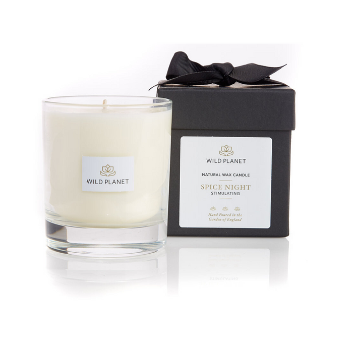 Spice Night Candle next to black packaging box tied with black ribbon by Wild Planet Products