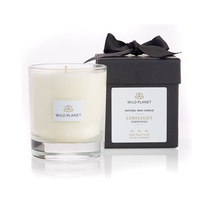 Wild Planet Products 220g Limelight aromatherapy candle next to black branded box with black ribbon
