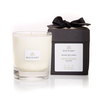 Aromatherapy Relax Candle in Midsummer next to black box with ribbon by Wild Planet Products