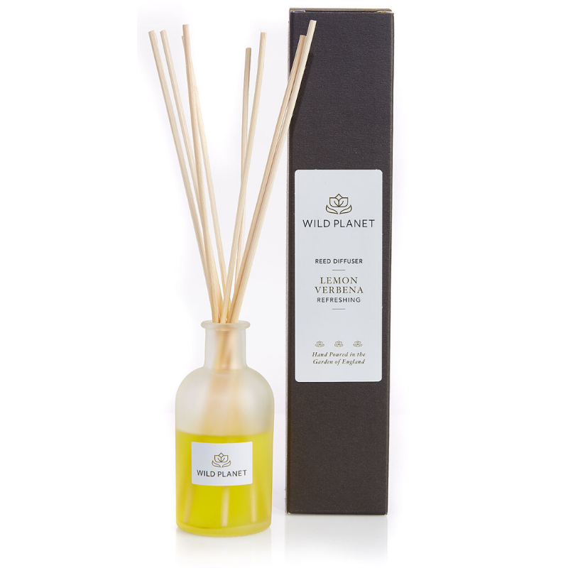 natural reed diffuser glass bottle with reed sticks next to black box packaging