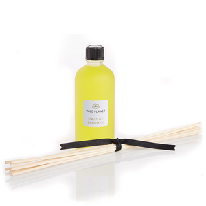 Orange Blossom Natural Diffuser Refill glass bottle with reed sticks tied with black ribbon