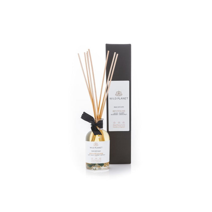 Revitalise Natural Reed Diffuser with Green Moss Agate gemstones next to black box by Wild Planet