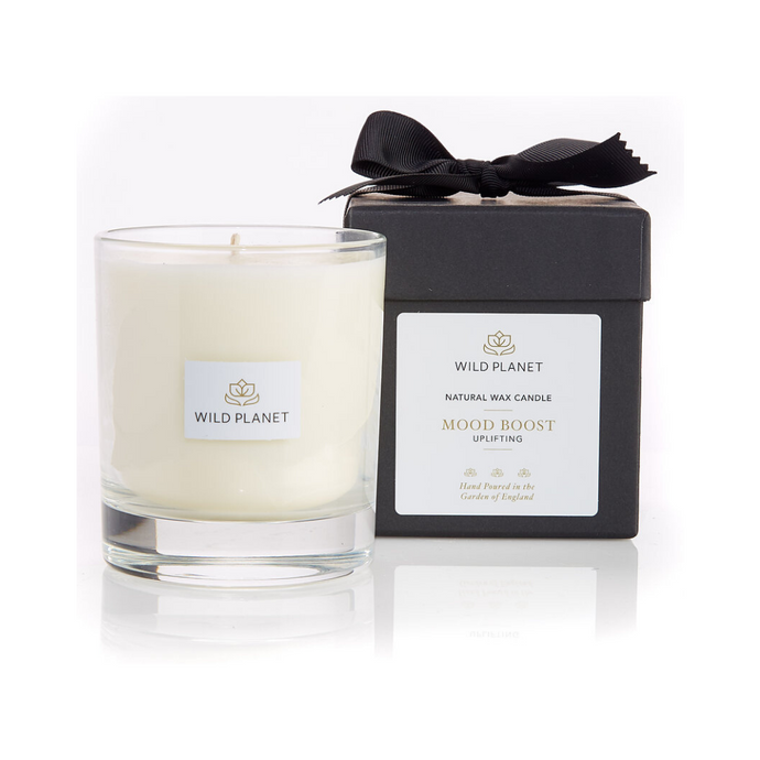 Wild Planet Products 220g Mood Boost aromatherapy candle next to black branded box with black ribbon