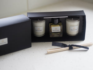 Open box of Reed Diffuser and Candle Gift Set by Wild Planet Products