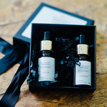 Essential Oils Duo Set in Soothe and Comfort two bottles in black box with lid off on wooden table