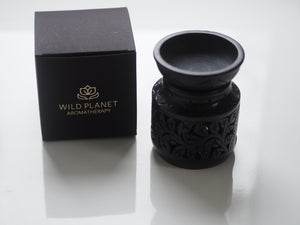 Oil Burner Wax Melter in black soapstone next to black box Wild Planet Aromatherapy words in gold