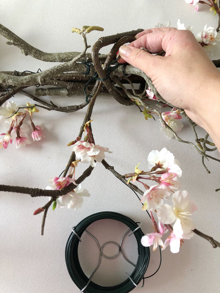 Attaching wire to blossom