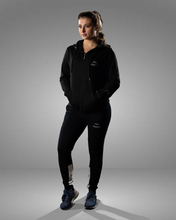 product shot of a female wearing a zipped black hoodie and joggers