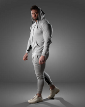 product shot of a male wearing a zipped grey hoodie and joggers