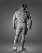 product shot of a male wearing a zipped grey hoodie and joggers - rear view