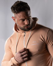 product shot of a male wearing a zipped dusty pink hoodie