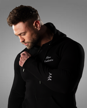 product shot of a male wearing a zipped black hoodie