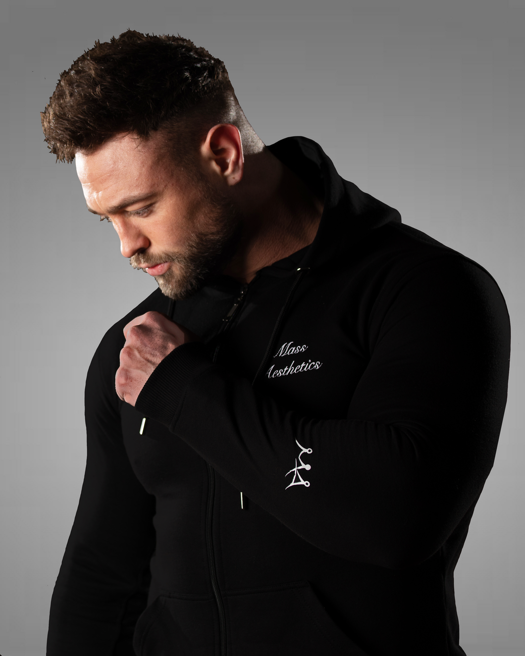 product shot of a male wearing a zipped black gym hoodie