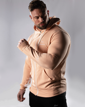 male wearing a zipped dusty pink Gym hoodie and Gym joggers