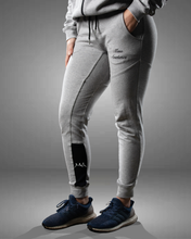 Woman wearing grey tapered fit joggers