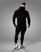 product shot of a male wearing a zipped black hoodie and joggers - rear view