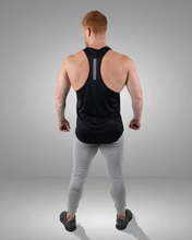 rear view of black racer back stringer vest