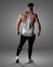 Rear view of grey stringer vest