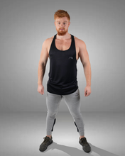 Male wearing a black stylish gym stringer vest