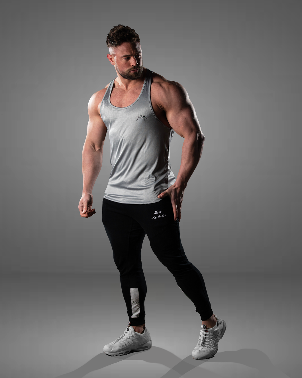 male wearing a grey stringer vest, perfect style