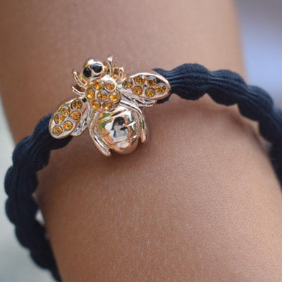 gold bee charm hairband. wear in hair or on wrist