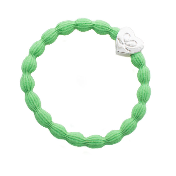 Green hairband with silver heart charm. Wear in your hair or on your wrist.