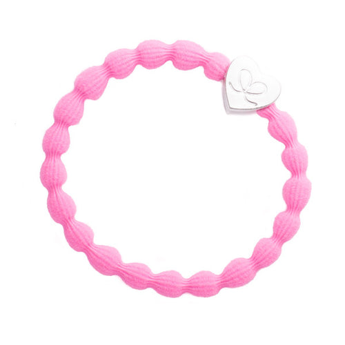 Neon pink hairband with silver heart charm. Wear in hair or on wrist.