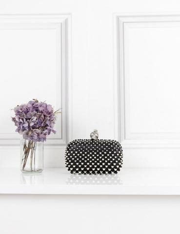 AlexanderMcQueen black pearl embellished leather skull box clutch- My Wardrobe Mistakes