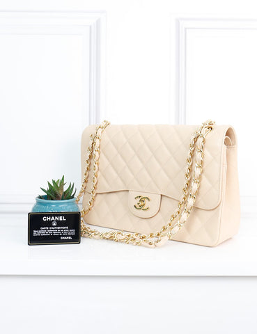 CHANEL BAGS One size / Cream CHANEL Classic Jumbo Double Flap Bag in cream quilted caviar leather
