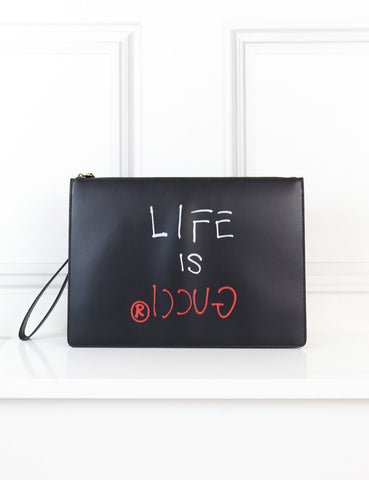 Gucci black clutch life is Gucci limited edition- My Wardrobe Mistakes