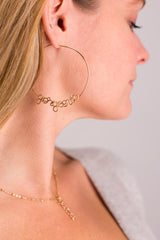 Model Wearing Atelier Paulin Gorgeous Hoop Earrings Gold
