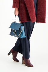 Crop Image Of Model Holding Chloé Faye Day Bag