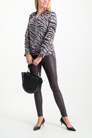 Full Body Image Of Model Wearing L'AGENCE Long Sleeve Nina Blouse Atticus Zebra