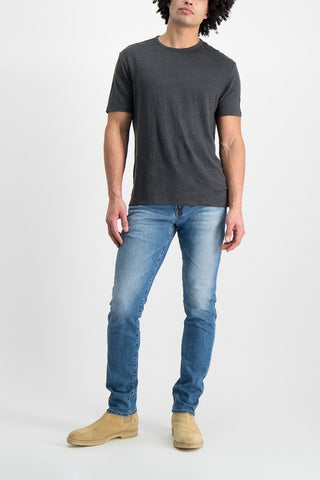 Full Body Image Of Model Wearing AG Men's Tellis Denim Rising Star