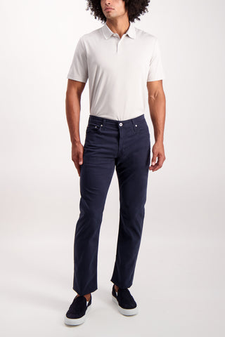 Full Body Image Of Model Wearing AG Stock Graduate New Navy Inseam