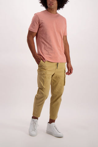 Full Body Image Of Model Wearing Alex Mill Men's City Cargo Pant Light Khaki