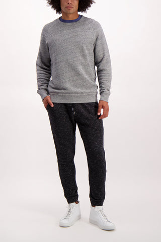 Full Body Image Of Model Wearing Alex Mill Men's French Terry Heather Sweatpant