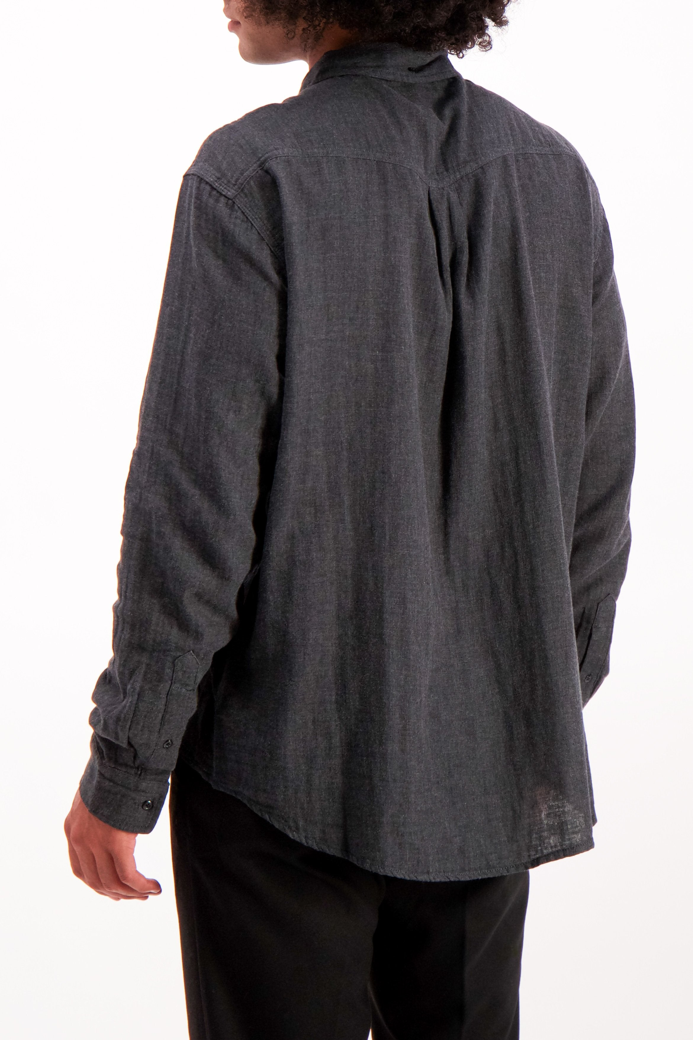 Back Crop Image Of Model Wearing Alex Mill Men's Long Sleeve Gauze Pocket Shirt Charcoal
