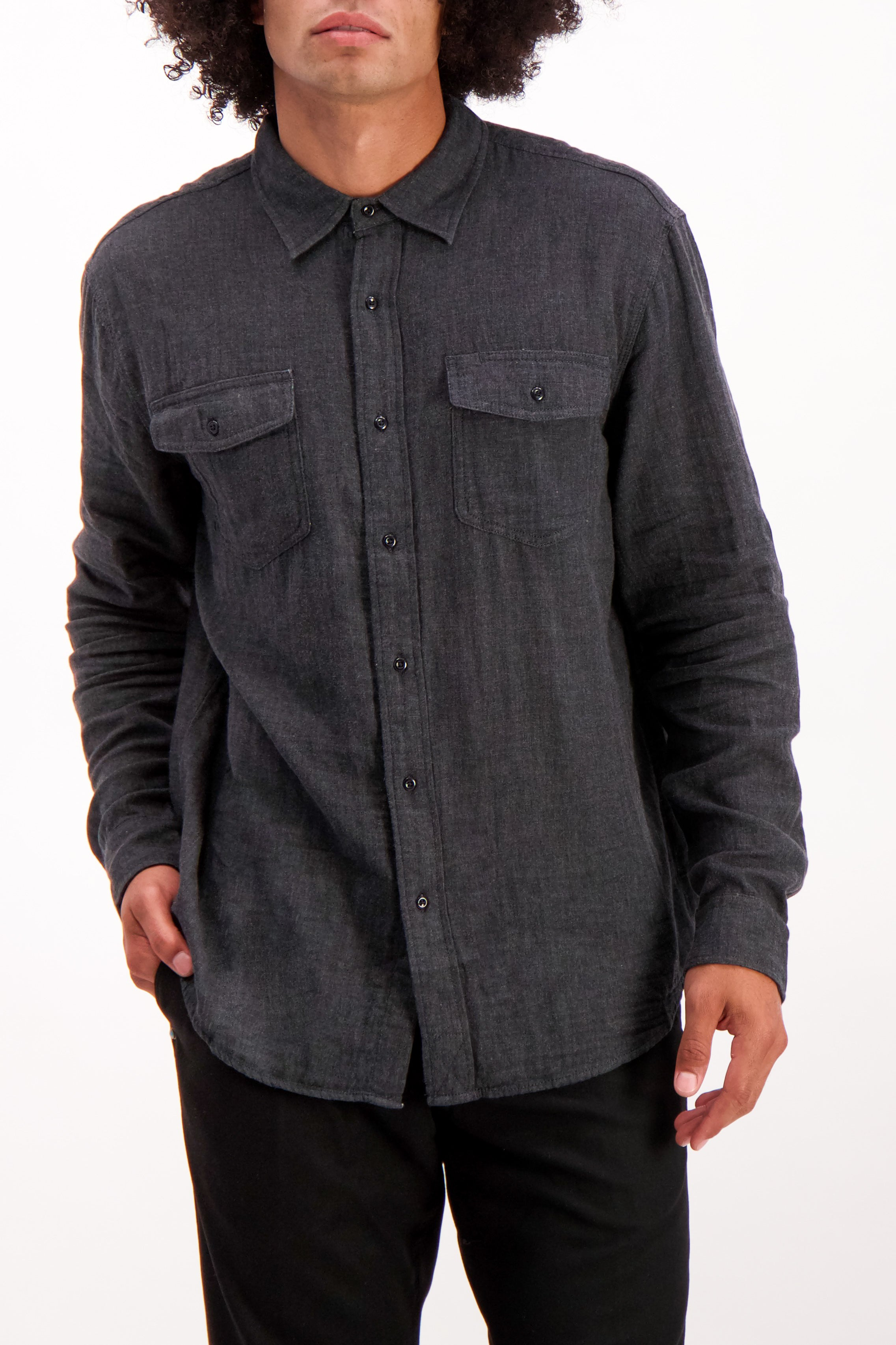 Front Crop Image Of Model Wearing Alex Mill Men's Long Sleeve Gauze Pocket Shirt Charcoal