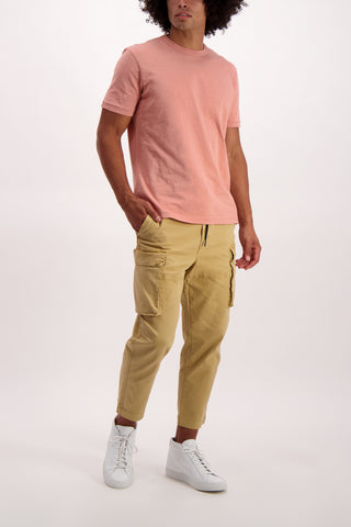 Full Body Image Of Model Wearing Alex Mill Men's Short Sleeve Slub Cotton Tee City Pink