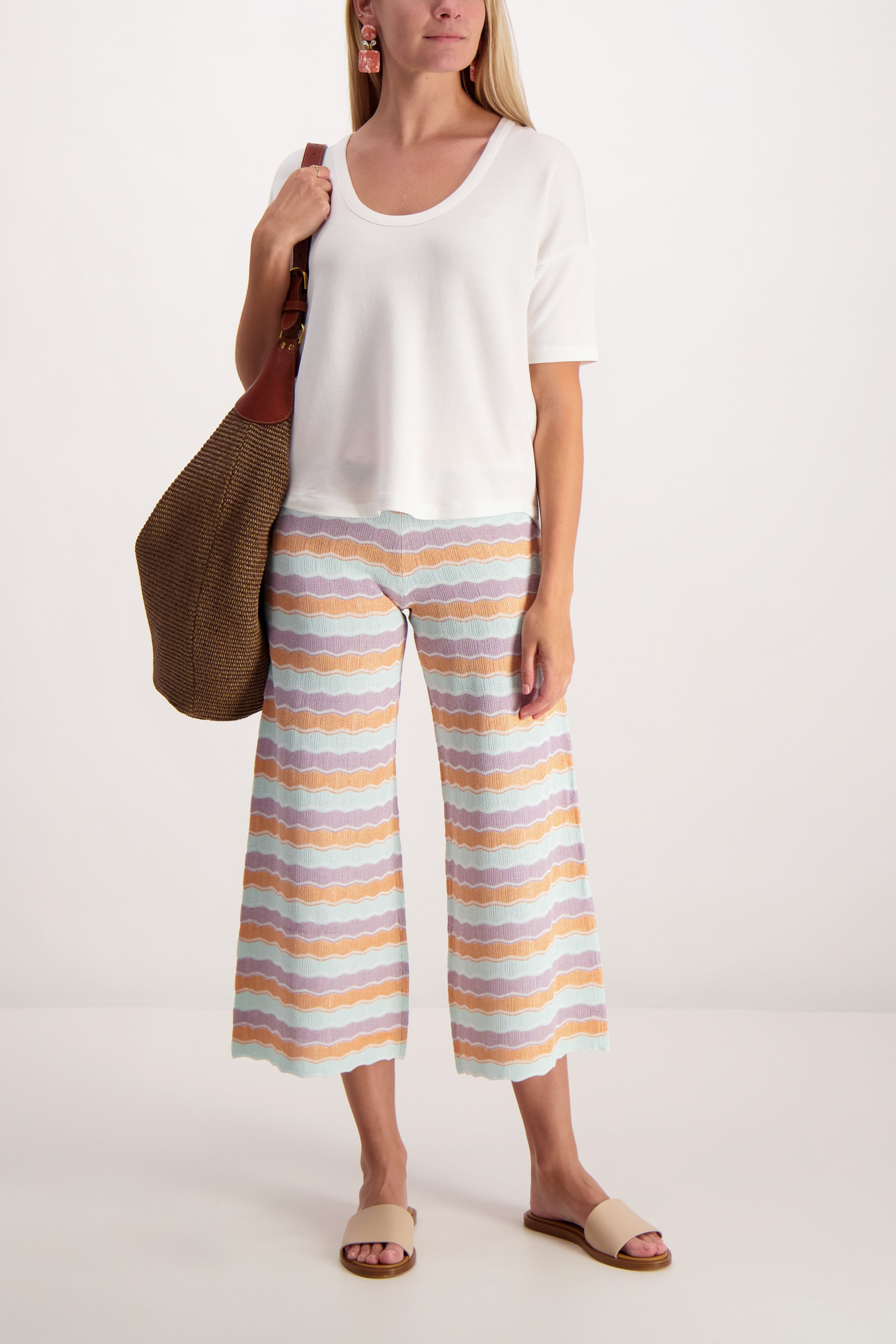 Full Body Image Of Model Wearing Alice & Olivia Basil Knit Pant