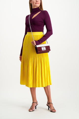 Full Body Image Of Model Wearing Alice & Olivia Ken Pleated Midi Skirt
